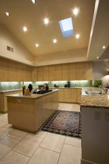 Spotlights illuminate an exquisite kitchen