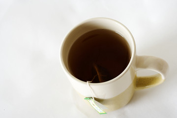 A mug of brewed tea on a white background