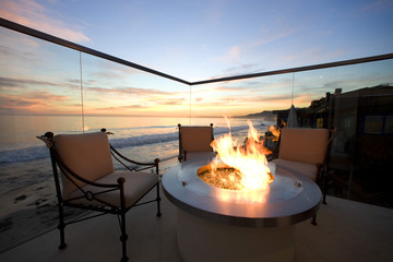 Front view of fire on a metal tabletop on a balcony