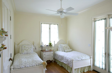 Side view of two single beds in a cozy bedroom