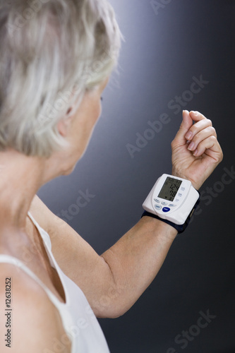 A senior woman with a heart rate monitor on her wrist