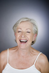 A senior woman laughing