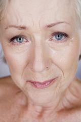 A senior woman crying
