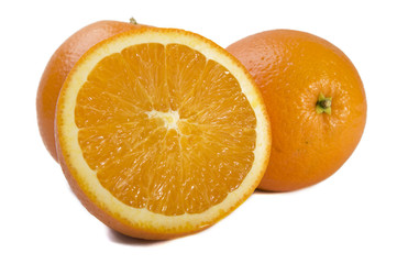 Three fresh oranges on white background