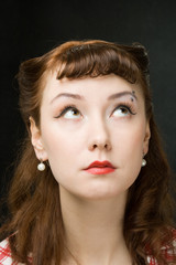 Pensive retro-style woman