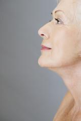 A profile portrait of an attractive senior woman