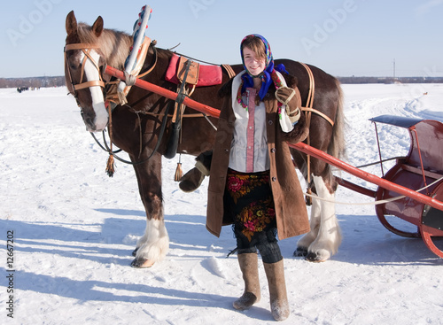 girl in  traditional clothes and horse-drawn