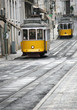 Two old yellow trams in Lisbon