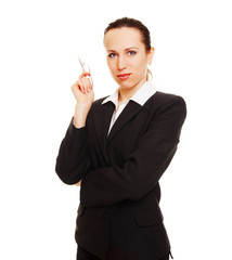 businesswoman holding glasses in her hand