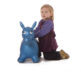 kneeling near plastic donkey young girl
