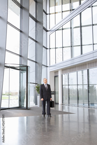 A mature businessman standing in the lobby
