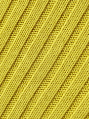 Closeup of yellow spring crochet sweater
