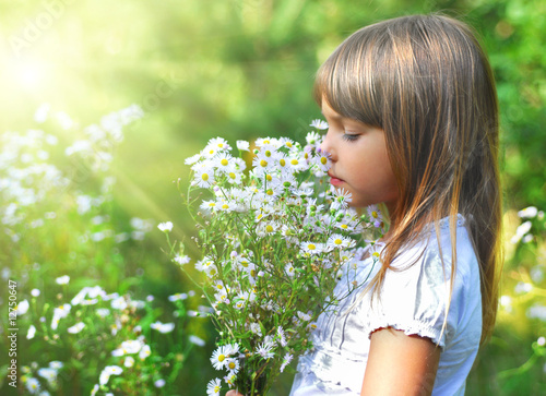 Little girl with the wild flowers