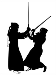 silhouette of two kendo fighters