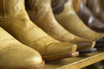 Close-up of new cowboy boots on shelf.