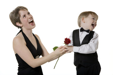 Mother and Son Holding Rose and Making Funny Faces