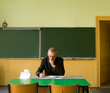 Teacher in empty classroom