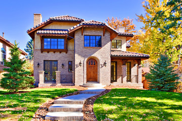 Home Front in All Brick with Green Lawn in Fall Season
