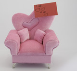 Card on Pink Chair