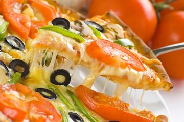 homemade pizza with fresh tomato olive mushroom cheese