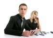 Business couple with many mobile telephones