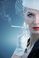 Beautiful smoking woman. Retro portrait