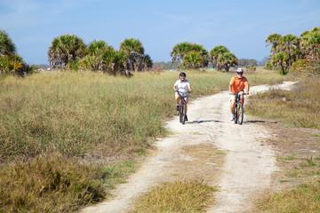 Seniors Riding Bikes at Beach