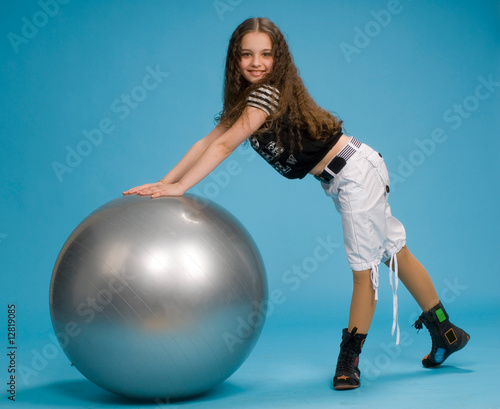 young girl with a big rubber ball