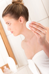 Body care series - Young woman cleaning her face