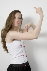 angry woman with beads showing her biceps. isolated on white