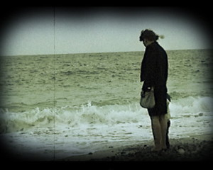 old home movie scene on the beach
