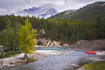 Red boats of a kayak on coast  river