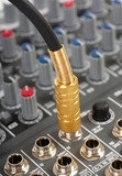 Audio cable with golden jack and control console poster