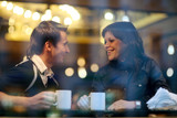 Happy young couple in cafe, having a great time together - Fine Art prints