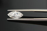 1.5 carat diamond being held with tweezers on black background poster