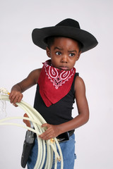 child cowboy holding a rope