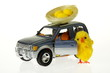 Easter chicken at car with nest on the roof - 12916464