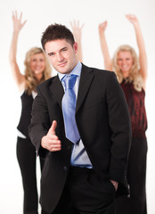 Businessman with cheering team