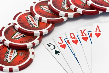 Playing chips and playing cards on a white background