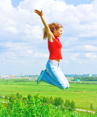 Girl jumping over the land