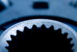 Closeup shot of an automobile metal part poster