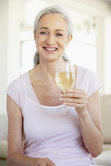 Woman Enjoying A Glass Of White Wine