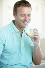 Man Enjoying A Glass Of White Wine