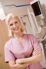 Portrait Of A Nurse In Front Of A Mammogram Machine