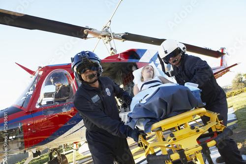 Leinwandbild Motiv Paramedics unloading patient from Medevac