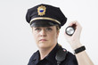 Portrait of a police woman holding a flashlight.