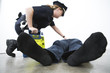 Police woman administering first aid to a person.