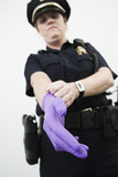 Woman police officer wearing a glove.