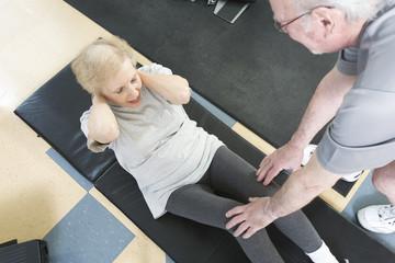 Senior couple exercising in the gym.