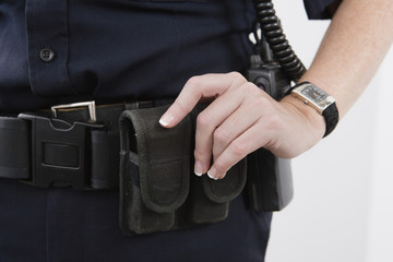 Close up of pouches on a cop's waist belt.